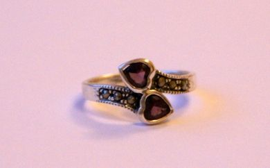 Sterling Silver Ring With Amethyst Cubic Zirconium Heart Shaped Stones